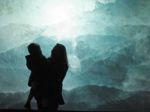 Our silhouette against a screen of blue ice.