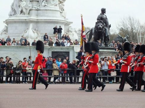 The changing of the guard at Buckinham Palace.