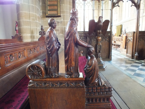 Pews with carved edges.