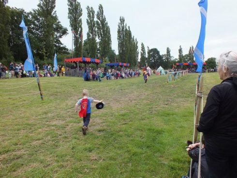 Our son running off to join the children's procession.