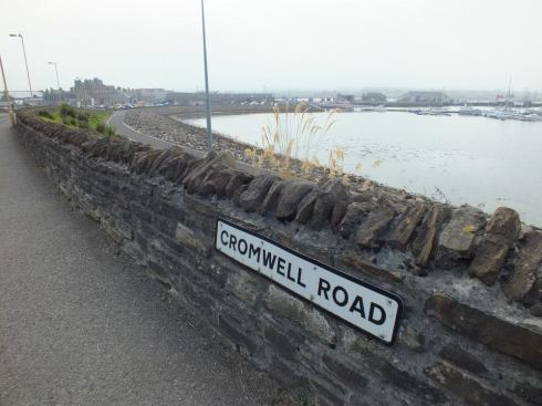 The tiny town of Kirkwall on the left.