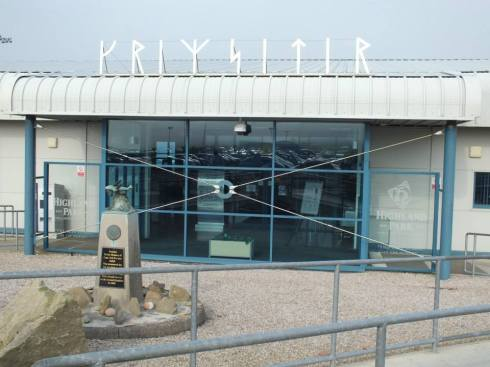 Kirkwall airport with sign in runes.