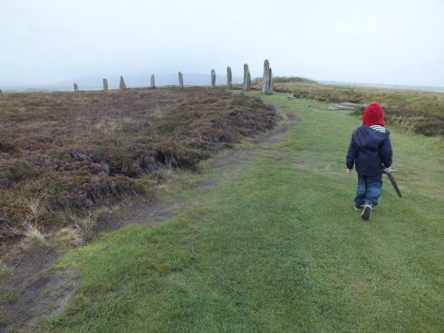 Our son with his Viking sword in the Ring of Brodgar.