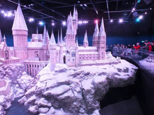1:24 miniature of Hogwarts with people on the side for scale.