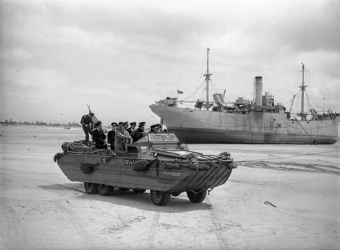 King George VI, accompanied by Admiral Sir Bertram Ramsay and the First Sea Lord, Admiral Sir Andrew Cunningham, touring the beaches at Normandy in a DUKW amphibious vehicle, 16 June 1944. (Wikipedia)