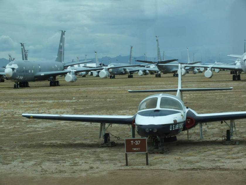 """A T-37 Tweet on """"Celebrity Row"""" with a bunch of Boeing C-135s in the background."""