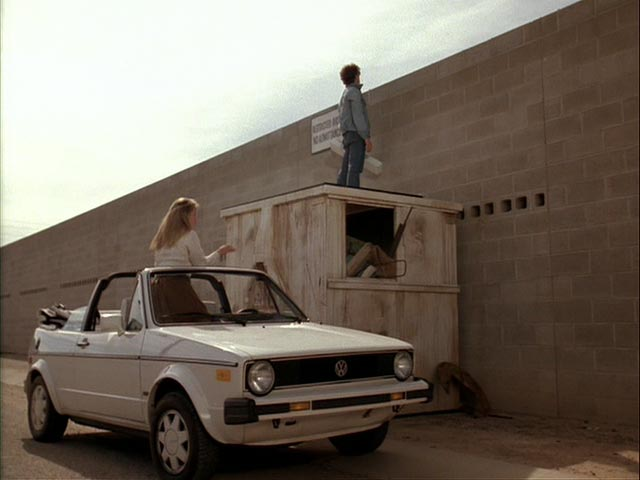 """Scene from """"Can't Buy Me Love"""" - Sneaking over the wall (internet photo)."""