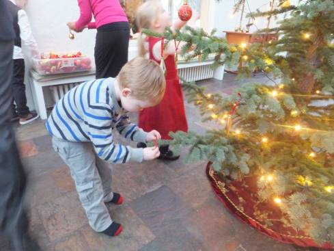 A helping decorate the embassy Christmas tree.