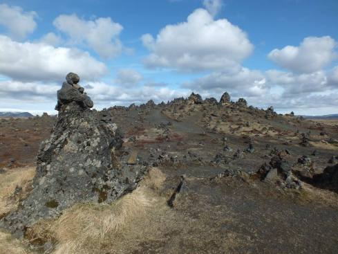 Lava ridge covered with stone cairns built by passersby looking for good luck on their travels.