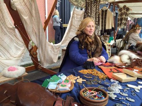 Woman selling handmade games and jewelry.