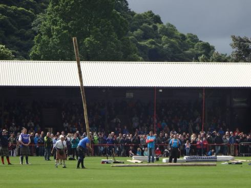 The caber toss at the Inverness Highland Games.