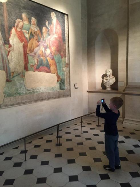 A taking photos at the Louvre.