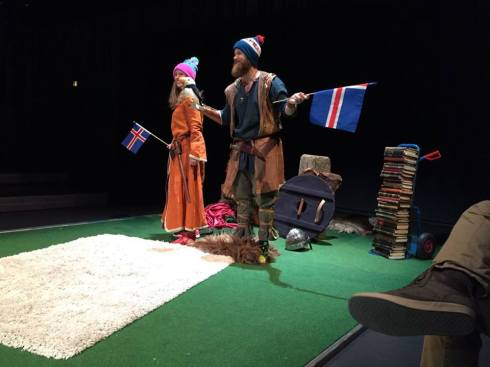 "The two-person cast of the Icelandic Sagas with ""the script"" in a pile in the background."